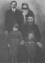 An Armenian priest and his family